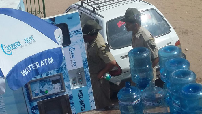 ASJ distributing free Mineral Water at Congress Adhiveshan 7
